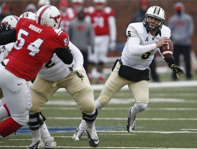 Dec 7, 2013; Dallas, TX, USA; UCF Knights quarterback Blake Bortles (5) scrambles out of the pocket on his way to a touchdown against the Southern Methodist Mustangs during the second half of an NCAA football game at Gerald J. Ford Stadium. UCF Knights won 17-13. Mandatory Credit: Jim Cowsert-USA TODAY Sports