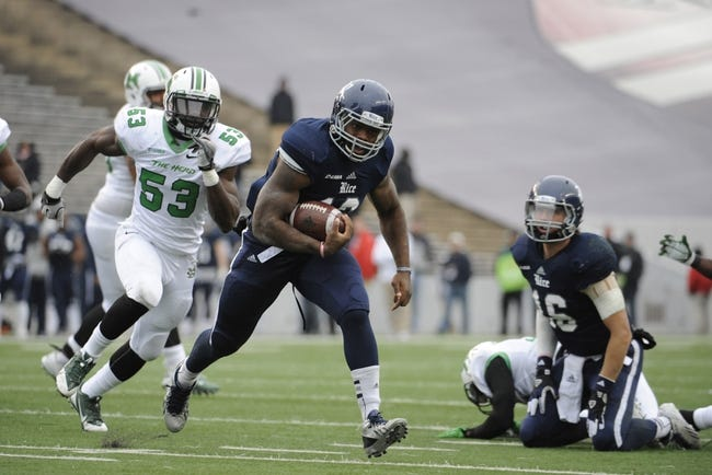 Dec 7, 2013; Houston, TX, USA; Rice Owls running back Charles Ross (12) runs for a touchdown ahead of Marshall Thundering Herd defensive lineman Alex Bazzie (53) during the second half of the Conference USA championship game at Rice Stadium. Rice beat Marshall 41-24. Mandatory Credit: Brendan Maloney-USA TODAY Sports
