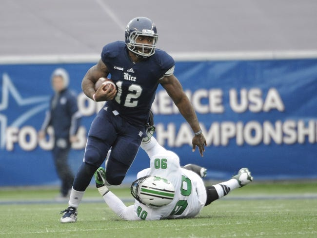 Dec 7, 2013; Houston, TX, USA; Rice Owls running back Charles Ross (12) avoids a tackle by Marshall Thundering Herd defensive end Arnold Blackmon (90) during the second half of the Conference USA championship game at Rice Stadium. Rice beat Marshall 41-24. Mandatory Credit: Brendan Maloney-USA TODAY Sports
