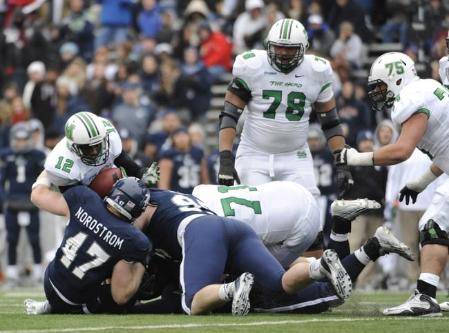 Dec 7, 2013; Houston, TX, USA; Rice Owls defensive end Brian Nordstrom (47) and nose tackle Ross Winship (99) sack Marshall Thundering Herd quarterback Rakeem Cato (12) during the second half of the Conference USA championship game at Rice Stadium. Rice beat Marshall 41-24. Mandatory Credit: Brendan Maloney-USA TODAY Sports