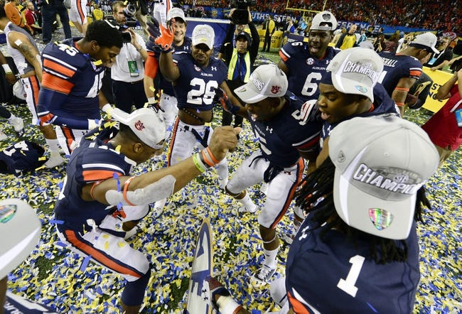 Dec 7, 2013; Atlanta, GA, USA; The Auburn Tigers play in confetti after defeating the Missouri Tigers in the 2013 SEC Championship game at Georgia Dome. Auburn won 59-42. Mandatory Credit: John David Mercer-USA TODAY Sports