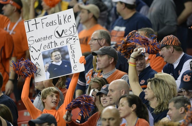 Dec 7, 2013; Atlanta, GA, USA; An Auburn Tigers fan holds up a sign referencing Auburn Tigers head coach Gus Malzahn during the fourth quarter of the 2013 SEC Championship game against the Missouri Tigers at Georgia Dome. Auburn won 59-42. Mandatory Credit: John David Mercer-USA TODAY Sports