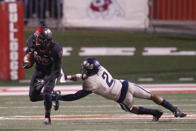 Dec 7, 2013; Fresno, CA, USA; Fresno State Bulldogs wide receiver Davante Adams (15) runs past Utah State Aggies safety Cameron Sanders (2) after making a catch in the second quarter at Bulldog Stadium. Mandatory Credit: Cary Edmondson-USA TODAY Sports