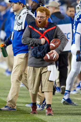 Dec 7, 2013; Charlotte, NC, USA; Florida State Seminoles ball boy Frankie Grizzle-Malgrat reacts during the fourth quarter in the game against the Duke Blue Devils at Bank of America Stadium. FSU defeated Duke 45-7. Mandatory Credit: Jeremy Brevard-USA TODAY Sports