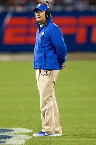 Dec 7, 2013; Charlotte, NC, USA; Duke Blue Devils head coach David Cutcliffe stands on the field during the fourth quarter against the Florida State Seminoles at Bank of America Stadium. FSU defeated Duke 45-7. Mandatory Credit: Jeremy Brevard-USA TODAY Sports