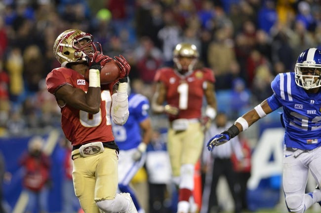 Dec 7, 2013; Charlotte, NC, USA; Florida State Seminoles wide receiver Kenny Shaw (81) catches a touchdown pass as Duke Blue Devils cornerback Deondre Singleton (33) defends in the third quarter at Bank of America Stadium. Mandatory Credit: Bob Donnan-USA TODAY Sports