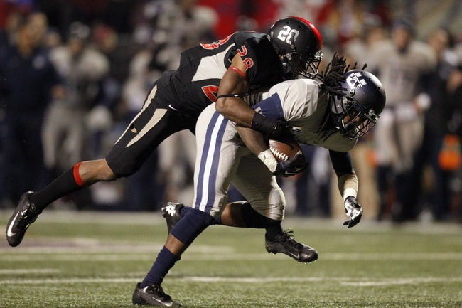 Dec 7, 2013; Fresno, CA, USA; Utah State Aggies wide receiver Ronald Butler (18) is tackled by Fresno State Bulldogs safety Charles Washington (28) in the fourth quarter at Bulldog Stadium. The Bulldogs defeated the Aggies 24-17. Mandatory Credit: Cary Edmondson-USA TODAY Sports