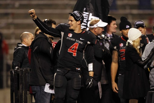 Dec 7, 2013; Fresno, CA, USA; Fresno State Bulldogs quarterback Derek Carr (4) acknowledges fans on stage after the Bulldogs defeated the Utah State Aggies 24-17 at Bulldog Stadium. Mandatory Credit: Cary Edmondson-USA TODAY Sports
