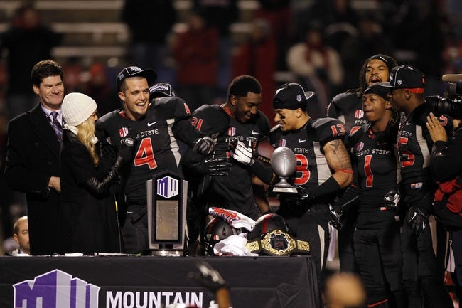 Dec 7, 2013; Fresno, CA, USA; Fresno State Bulldogs quarterback Derek Carr (4) is interviewed on stage after the Bulldogs defeated the Utah State Aggies 24-17 at Bulldog Stadium. Mandatory Credit: Cary Edmondson-USA TODAY Sports