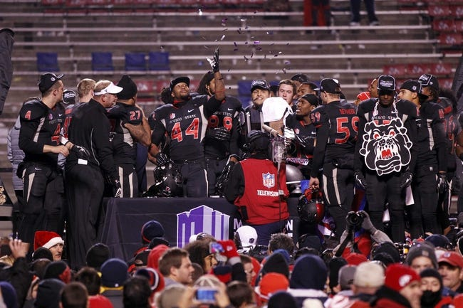 Dec 7, 2013; Fresno, CA, USA; Fresno State Bulldogs linebacker Jaamal Rose (44) tosses confetti in the air after the Bulldogs defeated the Utah State Aggies 24-17 at Bulldog Stadium. Mandatory Credit: Cary Edmondson-USA TODAY Sports