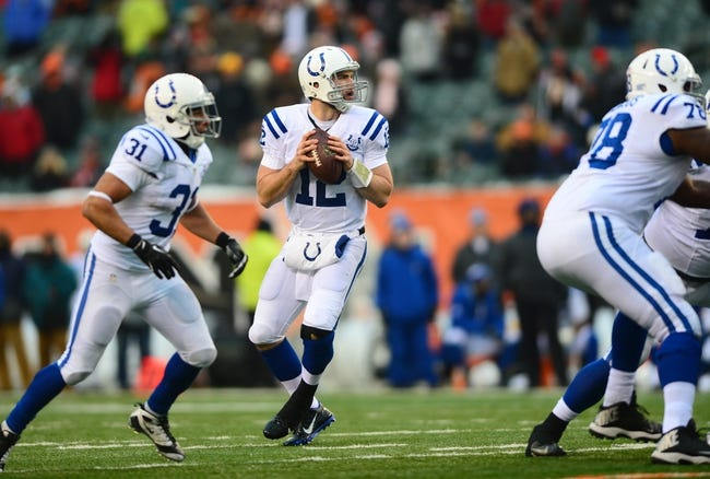 Dec 8, 2013; Cincinnati, OH, USA; Indianapolis Colts quarterback Andrew Luck (12) looks to pass during the fourth quarter against the Cincinnati Bengals at Paul Brown Stadium. Mandatory Credit: Andrew Weber-USA TODAY Sports