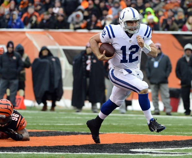 Dec 8, 2013; Cincinnati, OH, USA; Indianapolis Colts quarterback Andrew Luck (12) runs down field during the second half of the game at Paul Brown Stadium. Cincinnati Bengals beat Indianapolis Colts 42-28 Mandatory Credit: Marc Lebryk-USA TODAY Sports