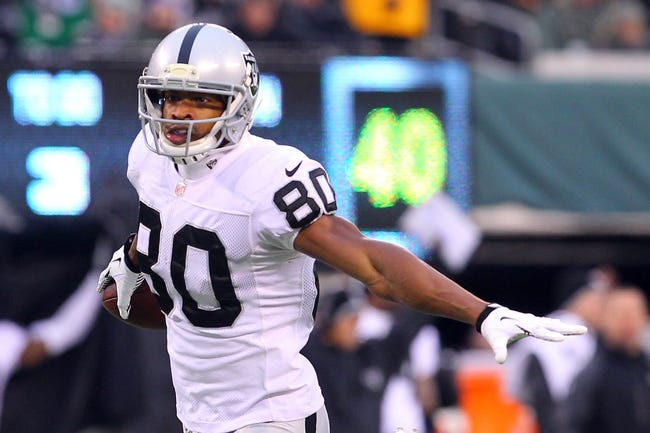 Dec 8, 2013; East Rutherford, NJ, USA; Oakland Raiders wide receiver Rod Streater (80) scores a touchdown during the second half at MetLife Stadium. The Jets defeated the Raiders 37-27.  Mandatory Credit: Ed Mulholland-USA TODAY Sports