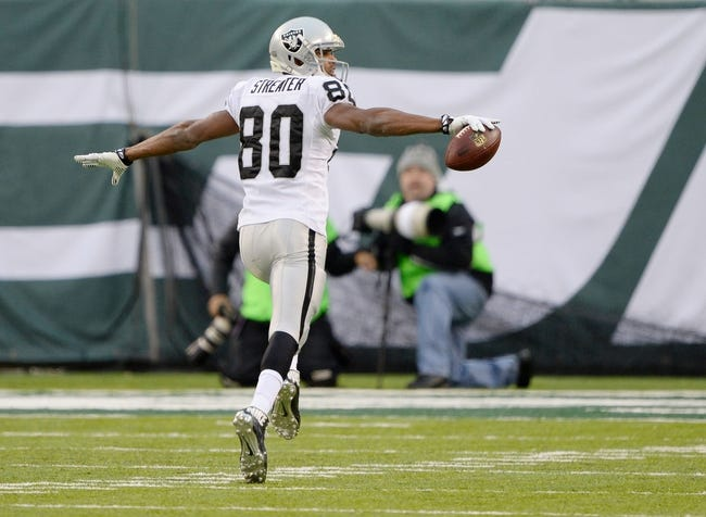 Dec 8, 2013; East Rutherford, NJ, USA; Oakland Raiders wide receiver Rod Streater (80) scores a touchdown against the New York Jets during the game at MetLife Stadium. Mandatory Credit: Robert Deutsch-USA TODAY Sports