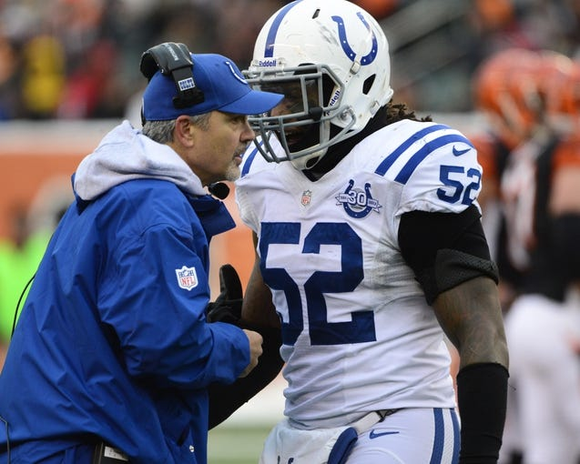 Dec 8, 2013; Cincinnati, OH, USA; Indianapolis Colts inside linebacker Kelvin Sheppard (52) talks with Indianapolis Colts head coach Chuck Pagano during the second half of the game at Paul Brown Stadium. Cincinnati Bengals beat Indianapolis Colts 42-28 Mandatory Credit: Marc Lebryk-USA TODAY Sports