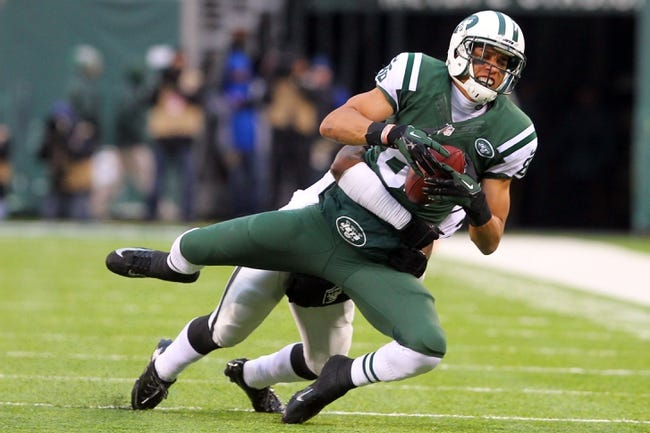 Dec 8, 2013; East Rutherford, NJ, USA; New York Jets wide receiver David Nelson (86) catches a pass against the Oakland Raiders at MetLife Stadium. The Jets defeated the Raiders 37-27.  Mandatory Credit: Ed Mulholland-USA TODAY Sports