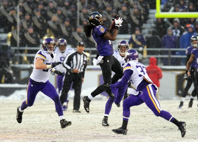 Dec 8, 2013; Baltimore, MD, USA; Baltimore Ravens wide receiver Marlon Brown (14) catches a pass in front of Minnesota Vikings safety Jamarca Sanford (33) at M&T Bank Stadium. Mandatory Credit: Evan Habeeb-USA TODAY Sports