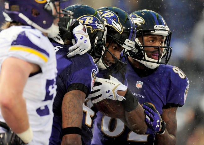 Dec 8, 2013; Baltimore, MD, USA; Baltimore Ravens wide receiver Marlon Brown (14) is congratulated by wide receivers Torrey Smith (82) and Jacoby Jones (12) after scoring the game-winning touchdown in the fourth quarter against the Minnesota Vikings at M&T Bank Stadium. Mandatory Credit: Evan Habeeb-USA TODAY Sports