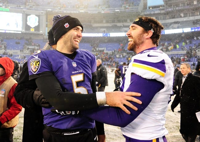 Dec 8, 2013; Baltimore, MD, USA; Baltimore Ravens quarterback Joe Flacco (5) is congratulated by Minnesota Vikings defensive end Jared Allen (69) after the game at M&T Bank Stadium. Mandatory Credit: Evan Habeeb-USA TODAY Sports