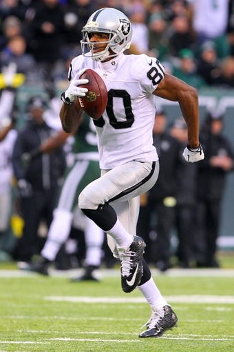 Dec 8, 2013; East Rutherford, NJ, USA; Oakland Raiders wide receiver Rod Streater (80) runs for a touchdown during the second half at MetLife Stadium. The Jets defeated the Raiders 37-27.  Mandatory Credit: Ed Mulholland-USA TODAY Sports