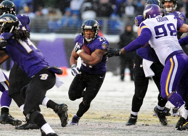 Dec 8, 2013; Baltimore, MD, USA; Baltimore Ravens running back Ray Rice (27) runs with the ball during the game against the Minnesota Vikings at M&T Bank Stadium. Mandatory Credit: Evan Habeeb-USA TODAY Sports