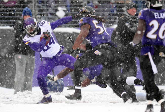 Dec 8, 2013; Baltimore, MD, USA; Minnesota Vikings wide receiver Cordarrelle Patterson (84) gets tackled by Baltimore Ravens linebacker Josh Bynes (56) at M&T Bank Stadium. Mandatory Credit: Evan Habeeb-USA TODAY Sports