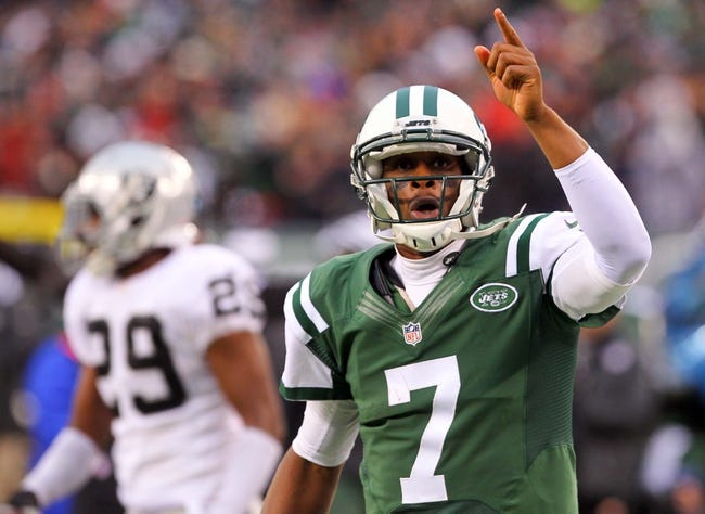 Dec 8, 2013; East Rutherford, NJ, USA; New York Jets quarterback Geno Smith (7) celebrates his first down run during the second half at MetLife Stadium. The Jets defeated the Raiders 37-27.  Mandatory Credit: Ed Mulholland-USA TODAY Sports