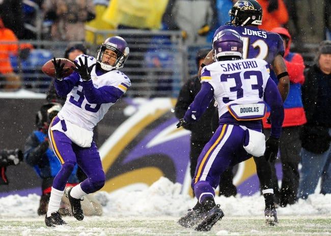 Dec 8, 2013; Baltimore, MD, USA; Minnesota Vikings cornerback Marcus Sherels (35) intercepts a pass intended for Baltimore Ravens wide receiver Jacoby Jones (12) at M&T Bank Stadium. Mandatory Credit: Evan Habeeb-USA TODAY Sports