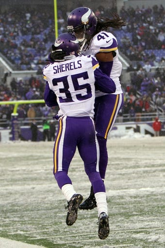 Dec 8, 2013; Baltimore, MD, USA; Minnesota Vikings cornerback Marcus Sherels (35) celebrates his interception with safety Mistral Raymond (41) against the Baltimore Ravens at M&T Bank Stadium. Mandatory Credit: Mitch Stringer-USA TODAY Sports