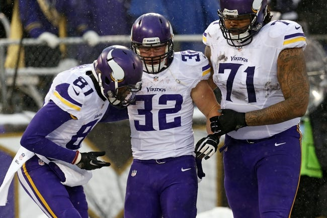 Dec 8, 2013; Baltimore, MD, USA; Minnesota Vikings running back Toby Gerhart (32) is met by wide receiver Jerome Simpson (81) and tackle Phil Loadholt (71) after an apparent injury during his fourth quarter touchdown run against the Baltimore Ravens at M&T Bank Stadium. Mandatory Credit: Mitch Stringer-USA TODAY Sports