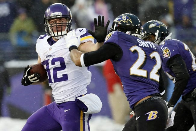 Dec 8, 2013; Baltimore, MD, USA; Minnesota Vikings running back Toby Gerhart (32) fends off Baltimore Ravens cornerback Jimmy Smith (22) during his fourth quarter touchdown run at M&T Bank Stadium. Mandatory Credit: Mitch Stringer-USA TODAY Sports