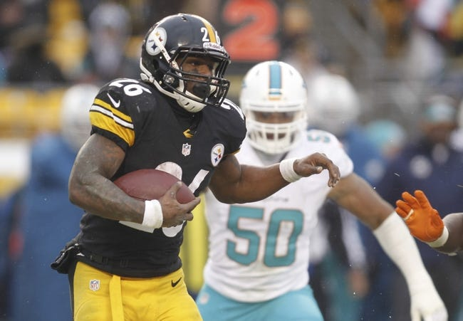 Dec 8, 2013; Pittsburgh, PA, USA; Pittsburgh Steelers running back Le'Veon Bell (26) carries the ball as Miami Dolphins defensive end Olivier Vernon (50) pursues during the fourth quarter at Heinz Field. The Miami Dolphins won 34-28. Mandatory Credit: Charles LeClaire-USA TODAY Sports
