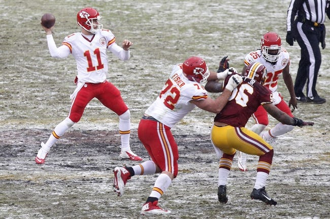 Dec 8, 2013; Landover, MD, USA; Kansas City Chiefs quarterback Alex Smith (11) throws the ball against the Washington Redskins in the second quarter at FedEx Field. The Chiefs won 45-10. Mandatory Credit: Geoff Burke-USA TODAY Sports