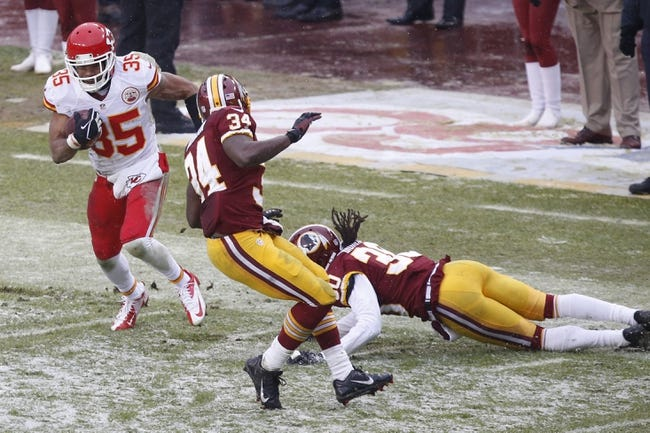 Dec 8, 2013; Landover, MD, USA; Kansas City Chiefs defensive back Quintin Demps (35) runs with the ball past Washington Redskins defensive back Trenton Robinson (34) and Redskins free safety E.J. Biggers (30) to score a touchdown in the second quarter at FedEx Field. The Chiefs won 45-10. Mandatory Credit: Geoff Burke-USA TODAY Sports