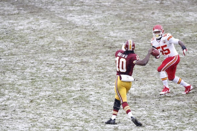 Dec 8, 2013; Landover, MD, USA; Washington Redskins quarterback Robert Griffin III (10) throws the ball as Kansas City Chiefs inside linebacker Akeem Jordan (55) chases in the second quarter at FedEx Field. The Chiefs won 45-10. Mandatory Credit: Geoff Burke-USA TODAY Sports