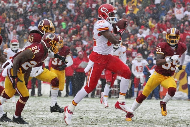Dec 8, 2013; Landover, MD, USA; Kansas City Chiefs wide receiver Dwayne Bowe (82) runs with the ball as Washington Redskins free safety David Amerson (39) chases in the first quarter at FedEx Field. The Chiefs won 45-10. Mandatory Credit: Geoff Burke-USA TODAY Sports