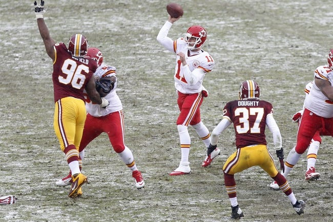 Dec 8, 2013; Landover, MD, USA; Kansas City Chiefs quarterback Alex Smith (11) throws the ball over Washington Redskins nose tackle Barry Cofield (96) in the second quarter at FedEx Field. The Chiefs won 45-10. Mandatory Credit: Geoff Burke-USA TODAY Sports