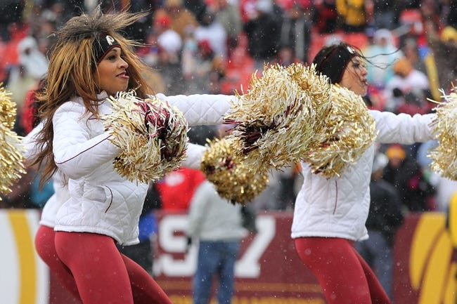 Dec 8, 2013; Landover, MD, USA; Washington Redskins cheerleaders dance on the field during a stoppage in play against the Kansas City Chiefs at FedEx Field. The Chiefs won 45-10. Mandatory Credit: Geoff Burke-USA TODAY Sports
