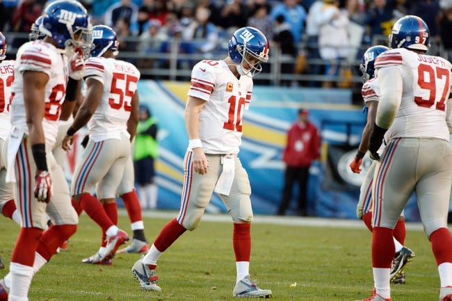 Dec 8, 2013; San Diego, CA, USA; [CAPTION]New York Giants quarterback Eli Manning (10) walks off the field after failing to pick up a first down late in the fourth quarter of the Giants loss to the San Diego Chargers. Mandatory Credit: Robert Hanashiro-USA TODAY Sports