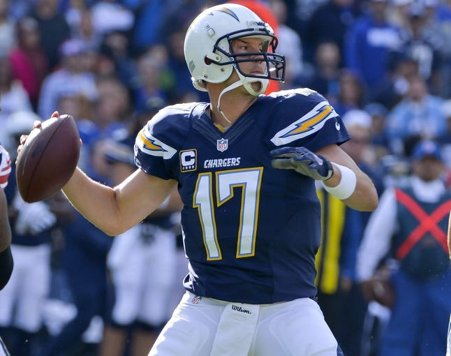 Dec 8, 2013; San Diego, CA, USA; San Diego Chargers quarterback Philip Rivers (17) throws a pass during the first half of the Chargers win over the New York Giants at Qualcomm Stadium. Mandatory Credit: Robert Hanashiro-USA TODAY Sports