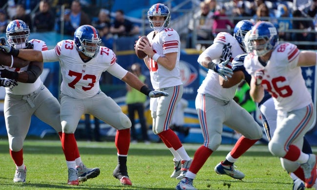Dec 8, 2013; San Diego, CA, USA; New York Giants quarterback Eli Manning (10) looks for an open receiver during the Giants loss to the San Diego Chargers at Qualcomm Stadium. Mandatory Credit: Robert Hanashiro-USA TODAY Sports