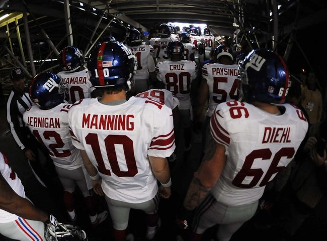 Dec 8, 2013; San Diego, CA, USA; New York Giants quarterback Eli Manning (10) in the tunnel prior to the game against the San Diego Chargers at Qualcomm Stadium. Mandatory Credit: Christopher Hanewinckel-USA TODAY Sports