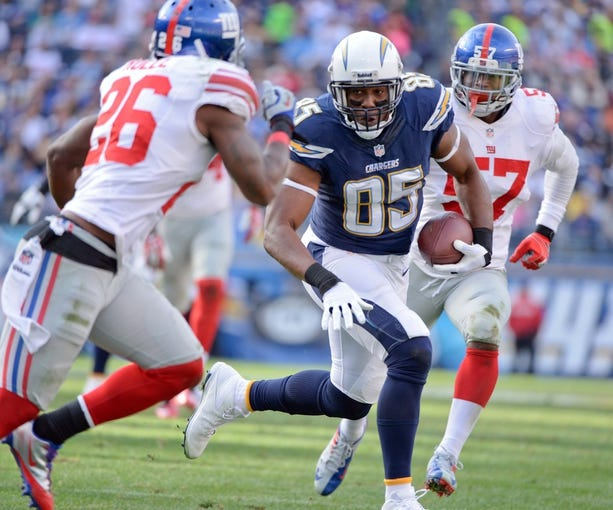 Dec 8, 2013; San Diego, CA, USA; San Diego Chargers tight end Antonio Gates (85) runs up field with the ball past New York Giants strong safety Antrel Rolle (26) during first half action at Qualcomm Stadium. Mandatory Credit: Robert Hanashiro-USA TODAY Sports