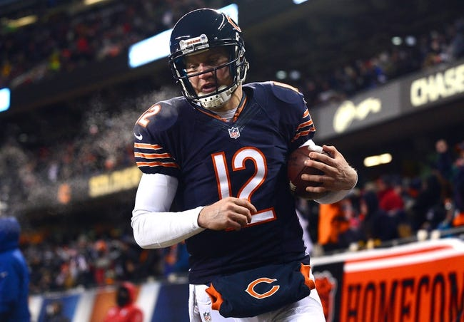 Dec 9, 2013; Chicago, IL, USA; Chicago Bears quarterback Josh McCown (12) runs out of bounds after getting a first down during the third quarter against the Dallas Cowboys at Soldier Field. Mandatory Credit: Andrew Weber-USA TODAY Sports