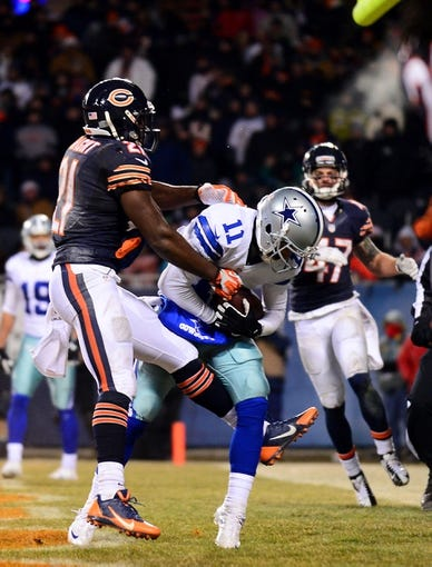 Dec 9, 2013; Chicago, IL, USA; Dallas Cowboys wide receiver Cole Beasley (11) makes a catch in the end zone for a touchdown while being defended by Chicago Bears strong safety Major Wright (21) during the fourth quarter at Soldier Field. Mandatory Credit: Andrew Weber-USA TODAY Sports
