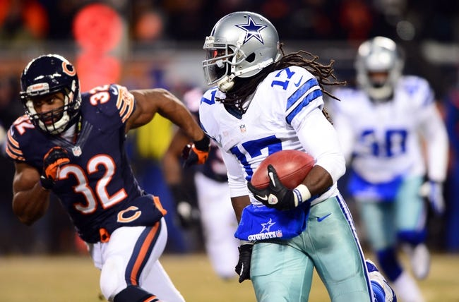 Dec 9, 2013; Chicago, IL, USA; Dallas Cowboys wide receiver Dwayne Harris (17) returns a kick off during the fourth quarter against the Chicago Bears at Soldier Field. Mandatory Credit: Andrew Weber-USA TODAY Sports