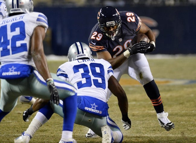 Dec 9, 2013; Chicago, IL, USA; Chicago Bears running back Michael Bush (29) rushes the ball against Dallas Cowboys cornerback Brandon Carr (39) during the third quarter at Soldier Field. Mandatory Credit: Mike DiNovo-USA TODAY Sports