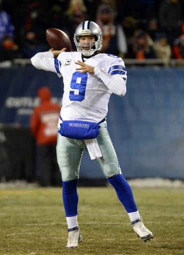 Dec 9, 2013; Chicago, IL, USA; Dallas Cowboys quarterback Tony Romo (9) drops back to pass against the Chicago Bears during the fourth quarter at Soldier Field. Mandatory Credit: Mike DiNovo-USA TODAY Sports