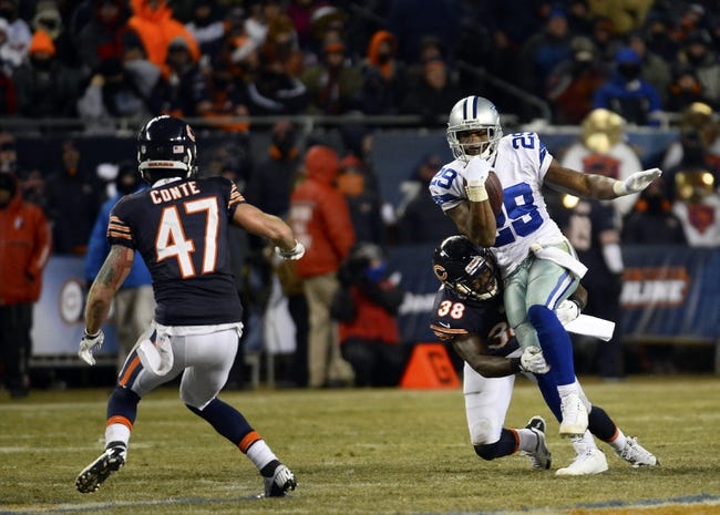 Dec 9, 2013; Chicago, IL, USA; Dallas Cowboys running back DeMarco Murray (29) rushes the ball against Chicago Bears free safety Chris Conte (47) during the fourth quarter at Soldier Field. Mandatory Credit: Mike DiNovo-USA TODAY Sports