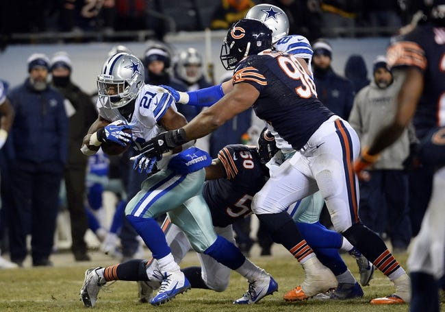 Dec 9, 2013; Chicago, IL, USA; Dallas Cowboys running back Joseph Randle (21) rushes the ball against Chicago Bears defensive tackle Corey Wootton (98) during the fourth quarter at Soldier Field. Mandatory Credit: Mike DiNovo-USA TODAY Sports